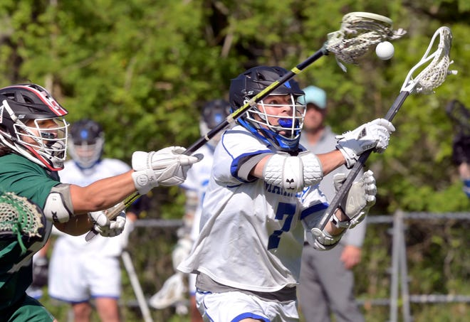 Cody Feldott of Falmouth Academy attempts to control the ball under pressure from Jackson Blake of Dennis-Yarmouth on Tuesday.