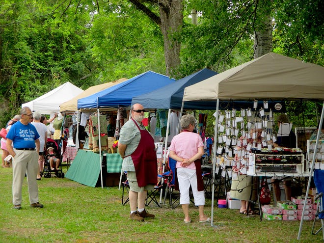 Attendees stroll past local artists' and crafters' booths at a previous Laurel Hill Arts and Heritage Festival. After its April rainout, this year's festival is June 5.