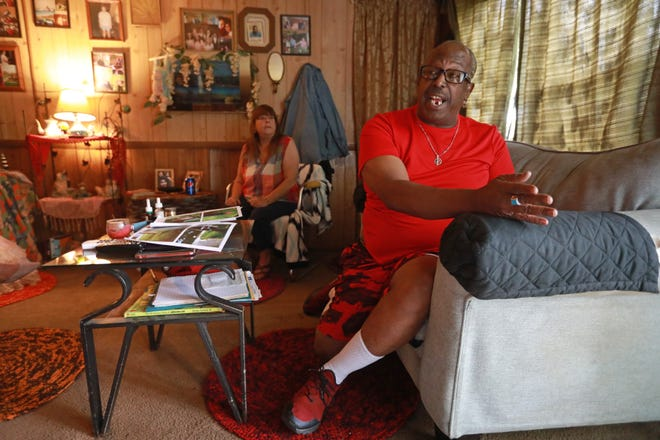 Leon Davis explains how he was the victim of a racially motivated attack in 2020 by three white men in New Lexington as his wife, Ronday, listens.