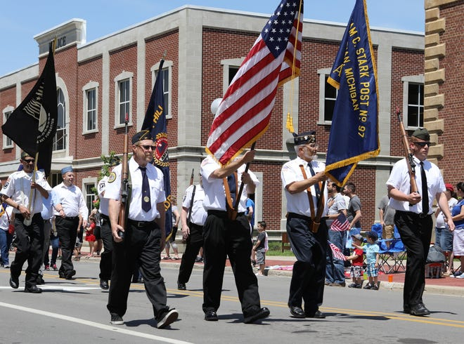 Color and honor guard members of the Adrian American Legion Post No. 97, participate in the 2019 Adrian Memorial Day parade in downtown Adrian. Communities across Lenawee County will be conducting parades, memorials and services Monday in commemoration of the Memorial Day holiday. Many parades and other community events were postponed in 2020 because of the COVID-19 pandemic.