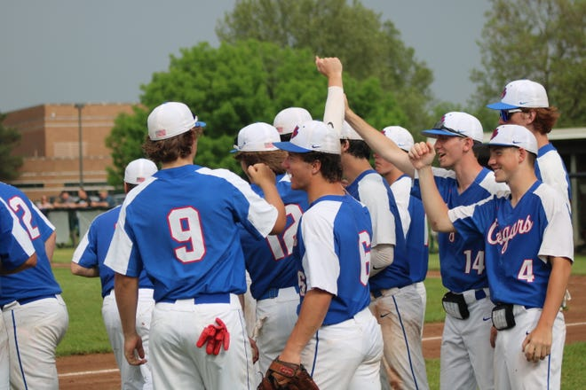 The Lenawee Christian baseball team breaks a huddle before heading into the field for the top of the seventh inning in their 3-0 victory over Britton Deerfield on Monday afternoon.