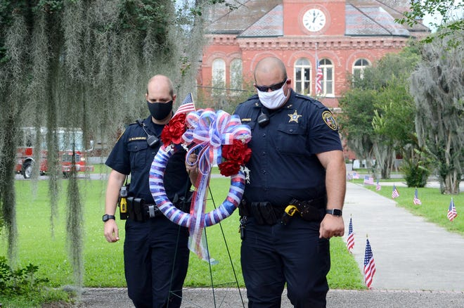 Lt. Dustin Ellinburg and Dy. Andrew Kehrees of the Ascension Parish Sheriff's Office participated in the Memorial Day service in 2020 in Donaldsonville.