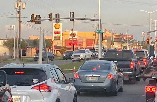 Vehicles line up at a traffic signal at the intersection of Hwy. 44 and Airline Hwy. in Gonzales May 22.