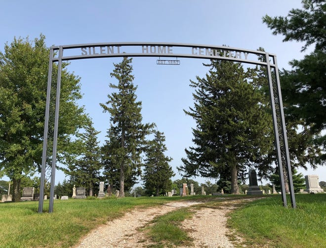 Constructed in 2012, the metal archway at Cameron's Silent Home Cemetery was inspired by an earlier one that graced the historic burial grounds.