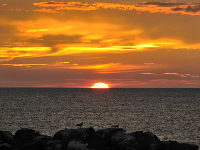 A sunset is viewed from Barracks Beach at Presque Isle State Park in Millcreek Township.
