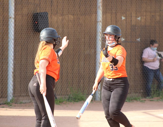 Wellsville's Lauren Cicirello (33) is congratulated by Maddie Spicer as she returns to the dugout after scoring a run in Monday's home win over Bolivar-Richburg.