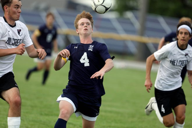 Notre Dame-West Burlington's Sam Brueck (4) keeps his eyes on the ball during the first half of their Class 1A boys soccer substate semifinal game against Hillcrest Academy  Monday May 24, 2021, at Notre Dame's Tackelson Field.