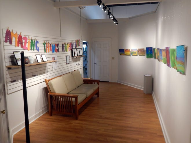The Mini Gallery at the Art Center of Burlington gives young and upcoming artists a chance to display their work. News about what's coming up at the Art Center on the left side; the other side spotlights emerging artists.
