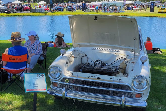 Jacksonville resident Ross Bremer's 1966 Lotus Cortina MK-I race car was displayed across the lake from many of the other Cars & Coffee classics.