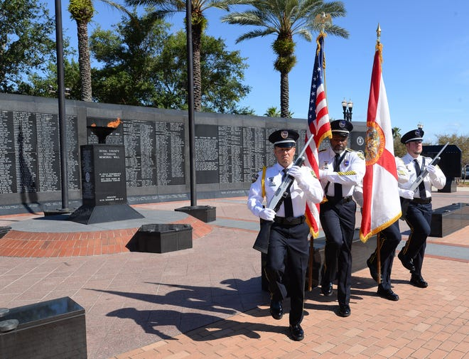 The Jacksonville Sheriff's Office Honor Guard marches outside the Veterans Memorial Wall to present colors during an advance tribute for a Memorial Day ceremony this year. Leaders in Jacksonville's veterans community have suggested moving the wall to Metropolitan Park and renaming it Veterans Memorial Park.