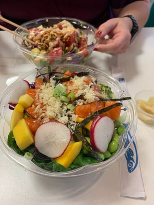 A half rice, half spring mix base loaded with salmon went down smoothly at Poke Bowl in Five Points.