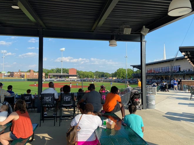 Spectators look on during Sunday's exhibition game at CaroMont Health Park featuring the Gastonia Honey Hunters and High Point Rockers.