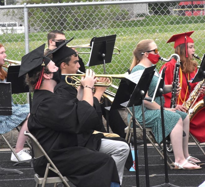"""During Orion's graduation on Sunday, May 23, seniors joined concert band to perform """"Fiesta La Vida"""" on the track at Charger Field"""