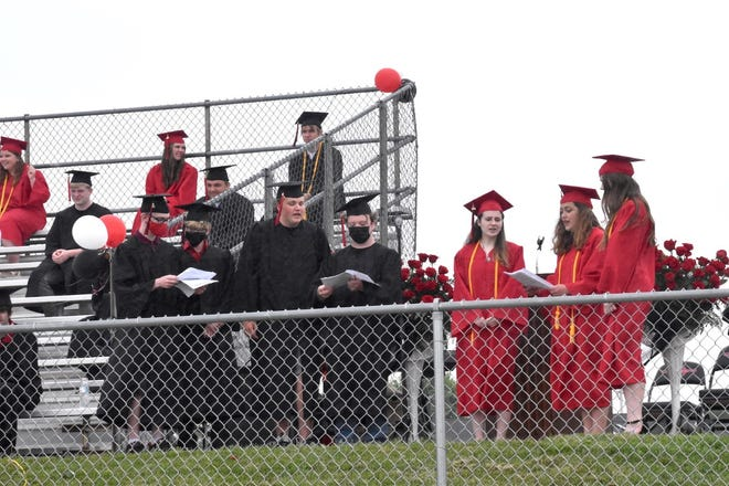 """Senior vocalists perform """"We're All in This Together"""" from """"High School Musical"""" during Orion's graduation on Sunday, May 23, at Charger Field."""