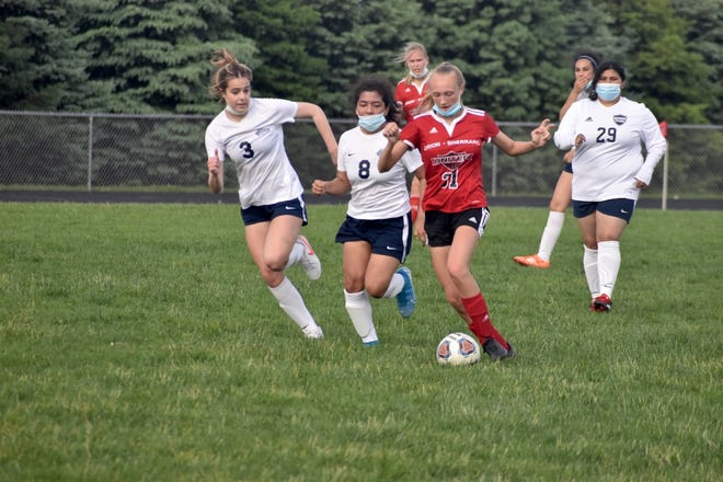 Orion-Sherrard's Olivia Thomsen (31) drives up the field with the ball during the Monmouth-Roseville match on Wednesday, May 19, at Charger Field. Following up the play is Addison Szymborski