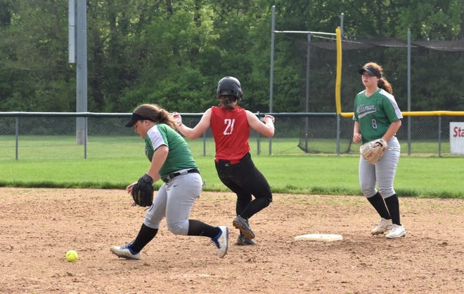 While an infielder tries to retrieve the ball, Orion's Ella Sundberg reaches second base in the second inning of the game on Wednesday, May 19, at the Alleman Athletic Complex in Moline.