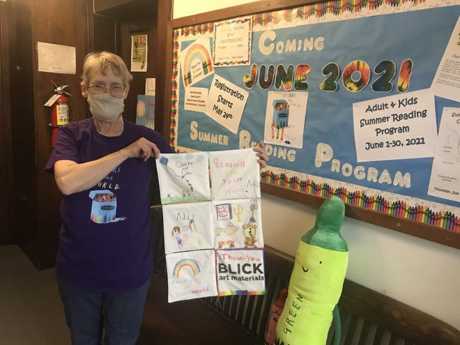 """Pictured is Sheri  Wood who is busy planning the Galva library's summer reading program, """"Reading Colors Your World."""""""