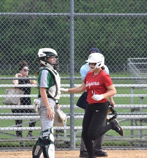 Grace Passno scores Orion's second run on Wednesday, May 19, when the Chargers played the Pioneers at the Alleman Athletic Complex in Moline.