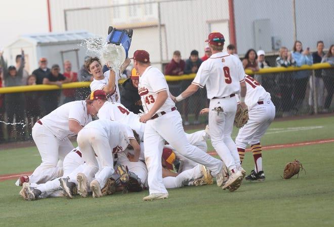 The Hays High baseball team celebrates after winning last week's regional at Indian Field.