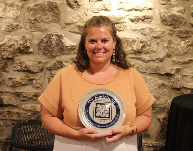 Tara Vance, Executive Director of the Norton County Community Foundation, was presented with a We Kan! award May 20 in a surprise presentation in the Heaton Building.