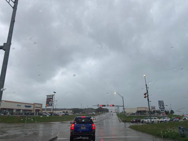 Storm clouds loom over Sherman Tuesday as rains added to what has already been a wet spring for the region.