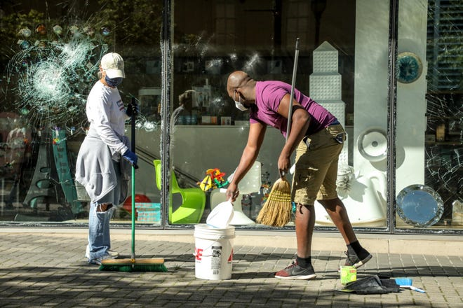 Cleanup efforts began on May 31, 2020, in downtown Grand Rapids, following riots which damaged 100 businesses city officials said.
