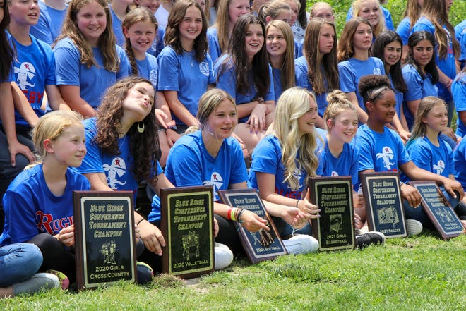 Rugby Middle School's girls pose with their conference championship plaques on Monday at Rugby.