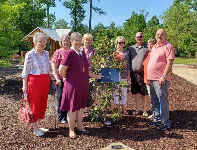 Joseph Montford Chapter, National Society of Daughters of the American Revolution recently planted a Magnolia tree and dedicated a plaque at the Onslow Discovery Garden in memory of Pat Walker, a tireless advocate of the Onslow Vietnam Veterans' Memorial Foundation. Her family continues the effort to finish her dream of a visitor center in the Memorial Gardens in Jacksonville. The Joseph Montford Chapter Service to Veterans Committee, headed by Pat Collins and assisted by Jane Fugate, raised the money necessary for the tree, plaque and arranged for the ceremony, which was led by Chapter Regent Donna Carlson-Stephens and Chaplain Pam Bell.