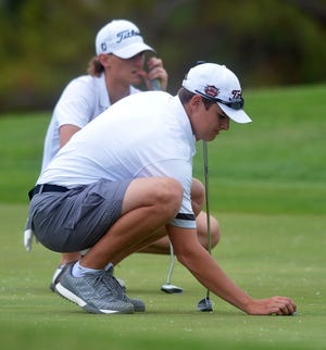 Hesston senior Jackson Humphreys prepares to putt during play Monday at the Class 3A state tournament at the Hesston Golf Course.