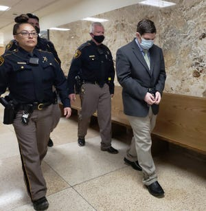 Lubbock County Sheriff's deputies escort Chance Copeland out of the 364th District Court where he was sentenced to life in prison for a deadly shooting in 2019.
