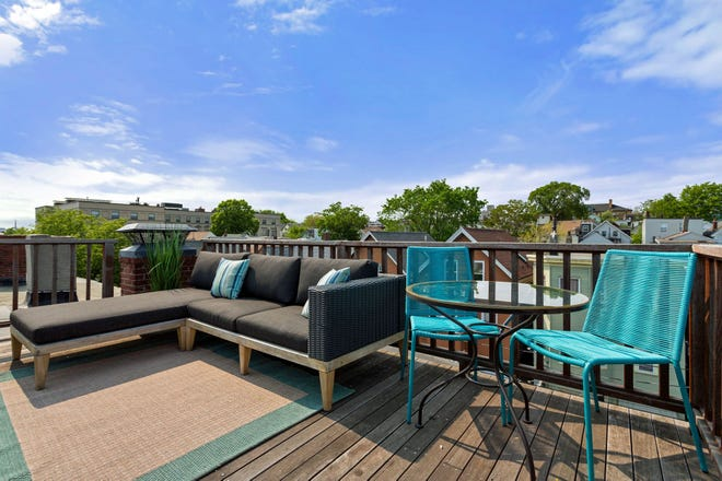 The mahogany roof deck that was built around the skylight offers phenomenal unobstructed views of downtown Boston, making it feel like an urban retreat.