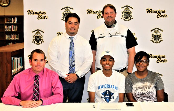 Antonio Blackwell (seated in center) signed with the University of New Orleans last week, where he will run track and cross country. Joining him at the signing were (seated, from left) coach Scott Lee, Blackwell, his mother Alicia,(standing) LHS principal Mark Mawae and LHS athletic director Justin Scogin.