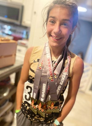 Anacoco's Sophia Acevedo-Swinney has continued to dominate the competition on the AAU track scene as a member of the Leesville Track Club.