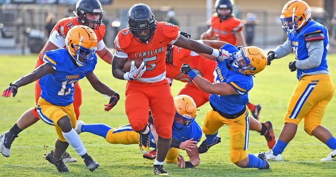 Lakeland's Davis Zaire gets a few tough yards against Charlotte during the Spring Classic hosted by Venice High School at Powell-Davis Stadium.