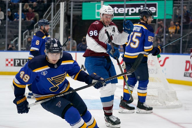 Colorado Avalanche's Mikko Rantanen (96) celebrates after scoring as St. Louis Blues' Ivan Barbashev (49) and Colton Parayko (55) skate past during the third period in Game 4 of an NHL hockey Stanley Cup first-round playoff series Sunday, May 23, 2021, in St. Louis.