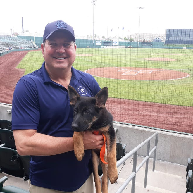 Shown is Mark Brandmeyer, owner of the Kansas City Monarchs, with his dog, also named Monarch, prior to the Monarchs' game Sunday against the Fargo-Moorhead RedHawks at Legends Field.