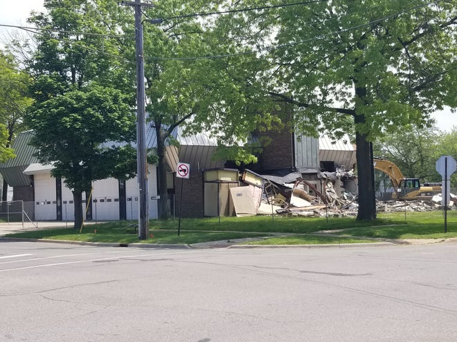 Demolition of the City of Monroe's old Central Fire Station officially began on Monday, as crews from Salenbien Trucking and Excavating of Dundee began tearing down the historic building.