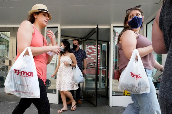 Shoppers exit a retail store in downtown Chicago on May 22. [AP Photo/Nam Y. Huh]