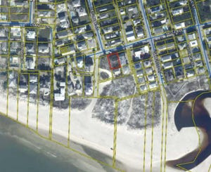 A small tract on Hotz Avenue in Grayton Beach will be purchased by Walton County for installation of a public restroom and other amenities.
