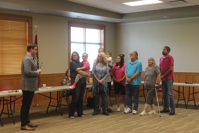 Van Buren Mayor Joe Hurst presented a glass plaque to the family of Greg Beyerle who died earlier this year. Beyerle worked the city for 20 years in the Street Department.