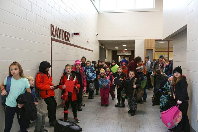 Charlevoix Elementary students wait for their parents at the end of the day. In a recent school board meeting, several parents expressed their concern about the possibility of increased class sizes for fifth grade at the school.