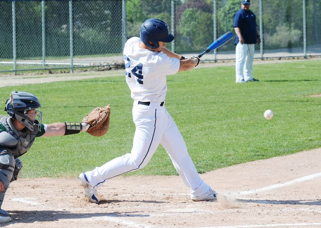 Petoskey's Ian Piehl swings through a pitch and drives it into the infield during the opener against Alpena.