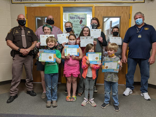 Several students at Vanderbilt Area School received recognition for May as part of Kiwanis' Terrific Kids and Teens program. Pictured are (back row from left) Otsego County Undersheriff Matt Muladore, school principal Matt Saunders, Athena Walter, Grace Snyder, Heidi Dykman, Dylan Gerrick, Dorian Burnette, and Kiwanian Eric Clink. Front row: Camden Rickman, Mykinzea Bruno, Maci Bunker, and Gage Haas.