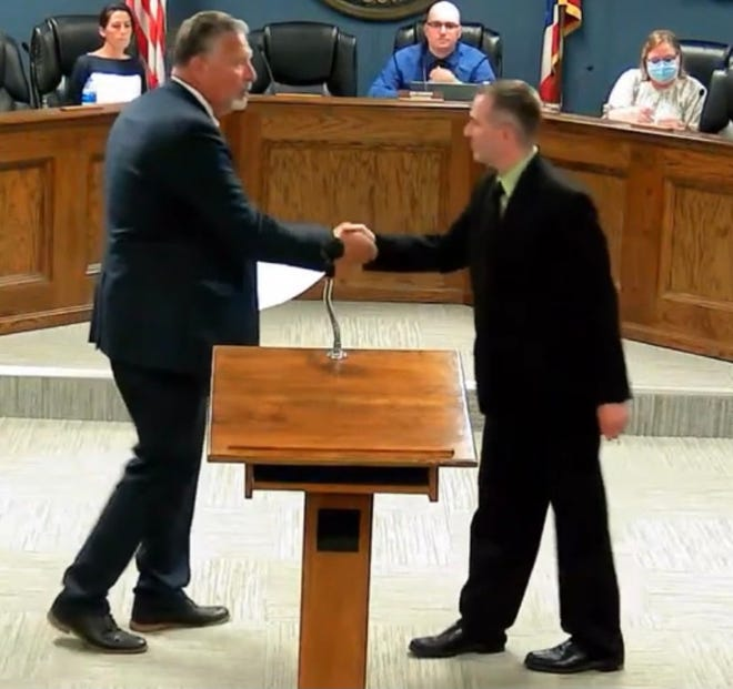 New Streetsboro City Councilman Anthony Lombardo shakes hands with Mayor Glenn Broska after being appointed.