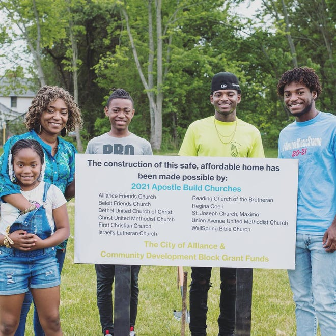 Talia Barboza and her children Braylee, Bralyn, Khoree and Khairee pose at the site of their future home on Monday, May 24, 2021.