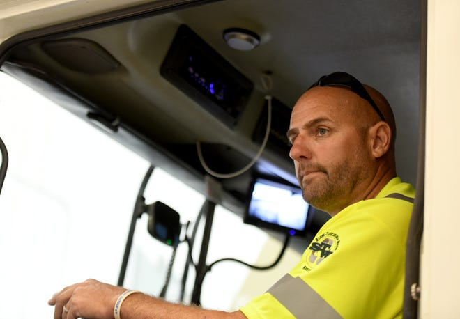 Driver Carl McKimmie of the Stark-Tuscarawas-Wayne Recycling District shows the Lytx camera driver safety system installed in all their vehicles. The cameras have improved on their safety record.