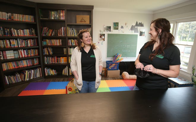 Hartville Migrant Ministry volunteer coordinator Jennifer Maurer, left, and ministry Director Theressa Earles, talk about the new children's library and play area recently completed at the center.