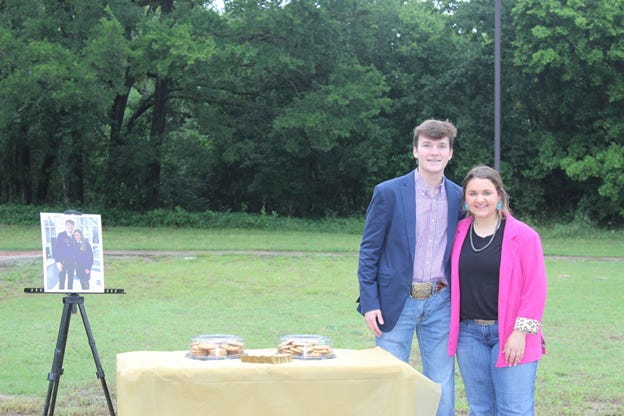 Ryan Hess and Chloe Krause are pictured at the ribbon-cutting ceremony on Monday evening for their Ford Leadership Scholars Project.