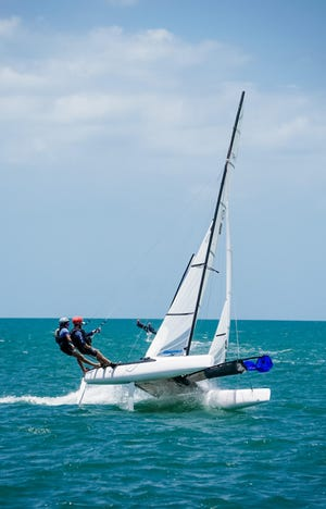 Sarasota's Luke King and Clearwater's Tanner DeMarzo aboard their Necra 15 sailboat over the weekend off Clearwater at the Nacra 15 Nationals. The two beat out nine other boats to take first place. COURTESY PHOTO