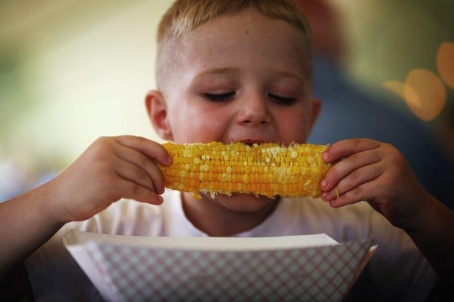 Preston Brondyke bites into an ear of sweet corn at the Chatham Jaycees signature festival, in this 2009 photo.